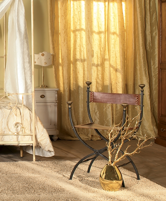Armchair in wrought iron and leather