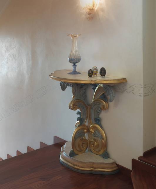 Carved leg console