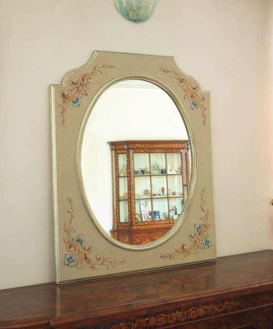 Shaped mirror with oval mirror
